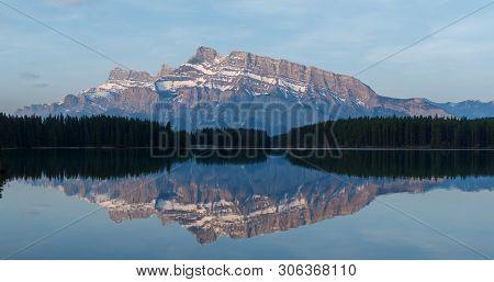 Mount Rundle Refelcting In Lake At Dawn
