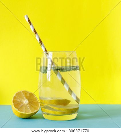 Detox Water. Lemon Water With Mint. Summer Drink. Infused Detox Water In Mason Jar On Yellow Backgro