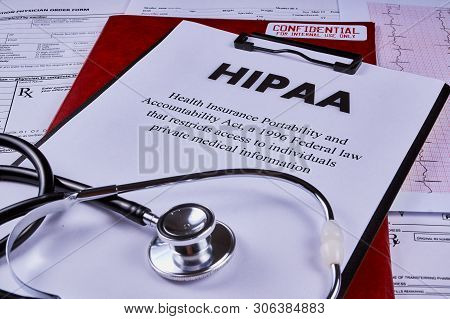 Health Insurance Portability And Accountability Act Hipaa, Red Folder With Inscription Confidential
