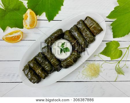 Delicious Dolma (sarma) Stuffed Grape Leaves & Rice, White Yogurt Sauce. Lebanese Dolma Sarma On Pla