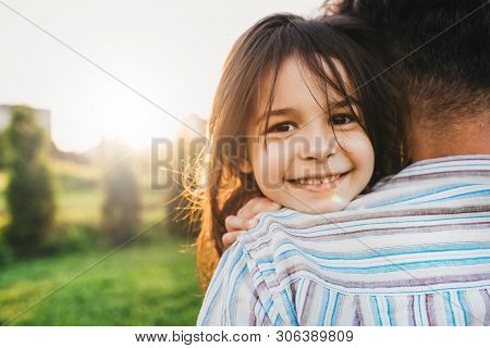 Closeup Image Of Happy Daughter Embraces Her Dad Feels Joyful. Happy Cute Little Girl Playing With F