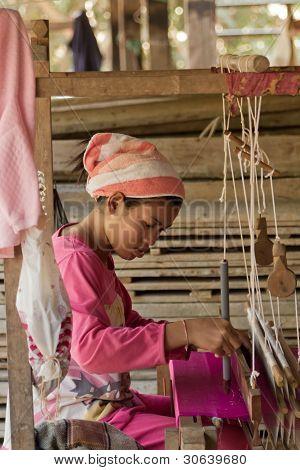 Woman weaving silk in Cambodia