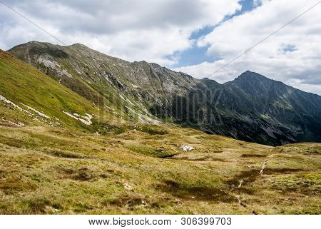 Gaborova Dolina Mountain Valley Covered By Mountain Meadow With Peaks Above In Zapadne Tatry Mountai