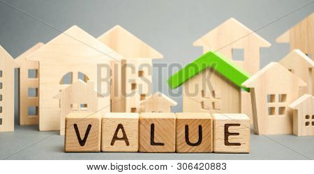 Wooden Blocks With The Word Value And Wooden Houses. Property Valuation And Housing. The Best Value