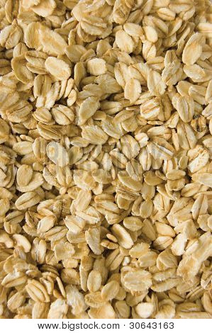 Oatmeal Background, Rolled Raw Oats Macro Closeup Vertical