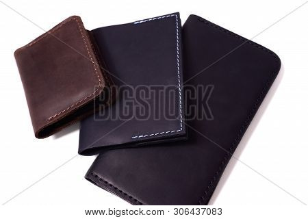 Handmade Brown Cardholder, Blue Passport Cover And Black Purse Isolated On White Background Closeup.
