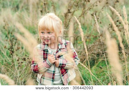 Fashionable Little Girl Walking At Countryside. Happy Girl With Blue Eyes And Blondy Hair. Kids Fash