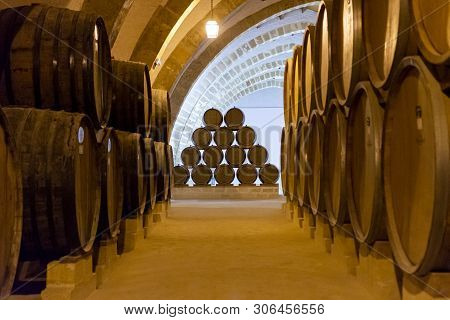 Vintage Wine Cellar With Old Oak Barrels, Production Of Fortified Dry Or Sweet Marsala Wine In Marsa