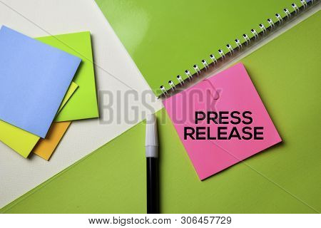 Press Release Text On Top View Office Desk Table Of Business Workplace And Business Objects.