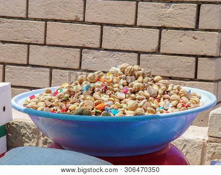 Basin With Different Nuts And Candies. Tunisia
