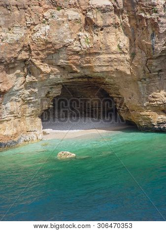 Small And Hardly Accessible Beach With A Grotto. Turkey