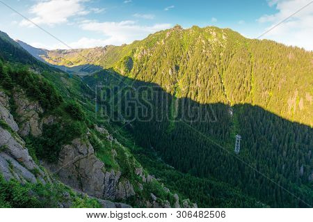 Mountain Ridge With Rocky Cliffs And Grassy Slopes. Beautiful Nature Scenery Of Fagaras Mountains, R