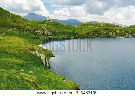 Glacier Mountain Lake In Summer. Beautiful Nature Scenery In Romania. Wonderful Background With Wate