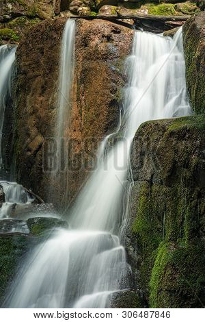 Mossy Boulders Of Waterfall. Summer Nature Background.