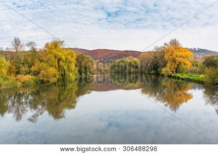 Calm Water Surface Of The Mountain River In Autumn. Wonderful Carpathian Landscape On An Overcast Da