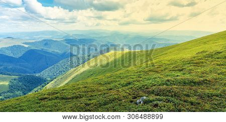 Grassy Hills And Slopes Of Carpathians.  Beautiful Summer Panorama Of Mountain Landscape On A Sunny