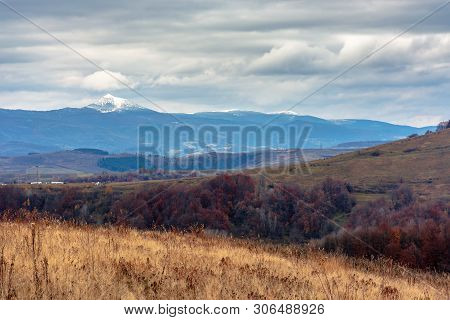 Beautiful Transcarpathian Landscape In November. Overcast Sky Above The Meadow With Weathered Grass