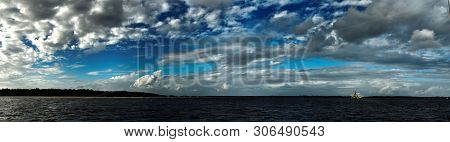 A Vibrant Atmospheric Nimbostratus Cloud Formation Displayed In A Cobalt Blue  Sky. Beauty In Nature