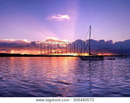A Delicate Tranquil Lavender Colored Stratocumulus Cloudy Sunset Seascape Over Smooth Sea Water With