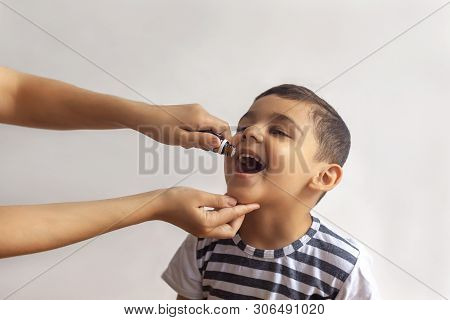 Child Immunization With Little Drop In Clinic. Doctor Providing Immunization Vaccines. Little Boy Ge