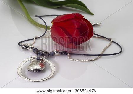 Silver Pendant-pendant On A Black And Silver Lace And A Red Tulip.
