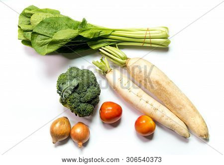 Onion, Tomato, Radish, Broccoli And  Choy Sum Vegetable On White Background