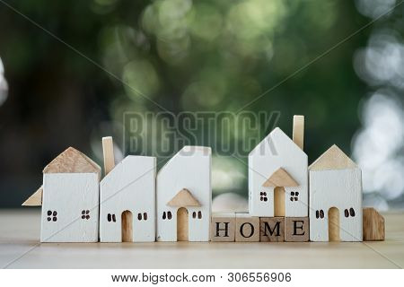 Miniature Wooden Home. Concept Of Real Estate, Purchase And Sale Of Housing. Affordable Housing At A