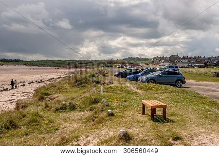 Alnmouth Beach And Car Park, Northumberland, England. 11 May 2019. Alnmouth Beach With Day Trippers