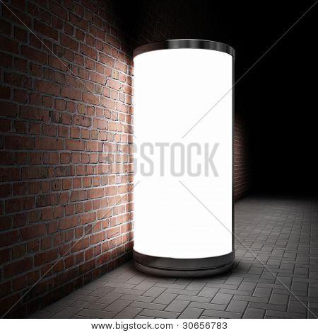 Blank street advertising billboard on brick wall at night