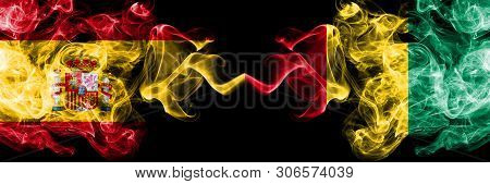 Spain Vs Guinea, Guinean Smoky Mystic Flags Placed Side By Side. Thick Colored Silky Smokes Flag Of