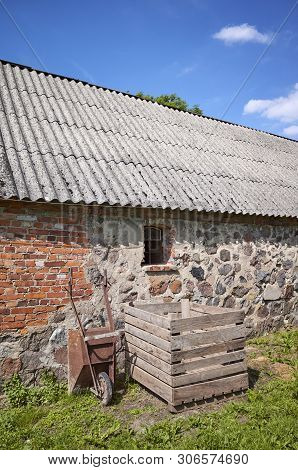 An Old Abandoned Building With Roof Made Of Carcinogenic Asbestos Tiles.