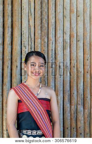 Portrait Of Kota Belud Kadazan Dusun Girl In Traditional Attire From Kota Belud District During Stat