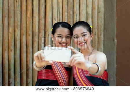 Two Kadazan Dusun Young Girls In Traditional Attire Taking Selfie During State Level Harvest Festiva