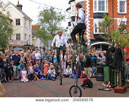 Sidmouth, Devon, England - August 5th 2012: Two Street Jugglers And Entertainers Perform In The Town