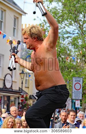 Sidmouth, Devon, England - August 5th 2012: A Street Juggler Takes The Applause From An Appreciative