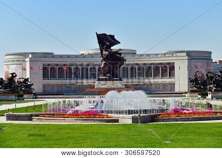 Pyongyang, North Korea - May 2, 2019: Museum Of Victory. Statue Of A Soldier With A Flag At The Entr