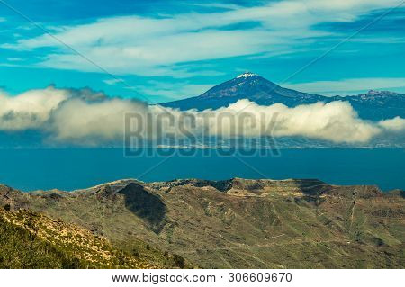 Spectacular View Of Tenerife And Volcano Teide With Snow Spots On The Top. Bright Blue Sky And Beaut