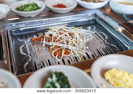 Grilled Marinated Pork Kimchi Topped With Bean Sprout Eaten With Various Side Dishes Of Vegetable An