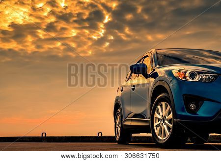Blue Compact Suv Car With Sport And Modern Design Parked On Concrete Road By The Sea With Beautiful
