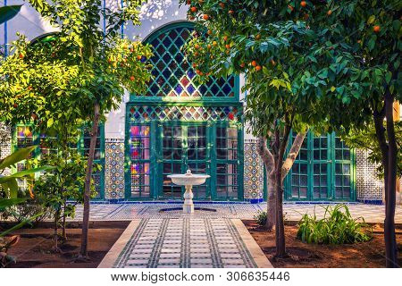 Marrakech, Morocco - January 10, 2019 : Small White Fontaine Among Orange Trees Of Jardin Majorelle