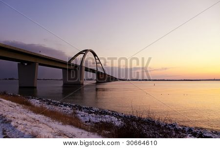 Fehmarn Sound Bridge at the Baltic Sea at sunset