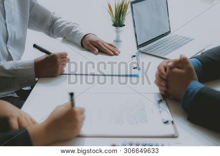 Couple Buying Renting House Signing Mortgage Contract Agreement With Realtor Real Estate Agent.