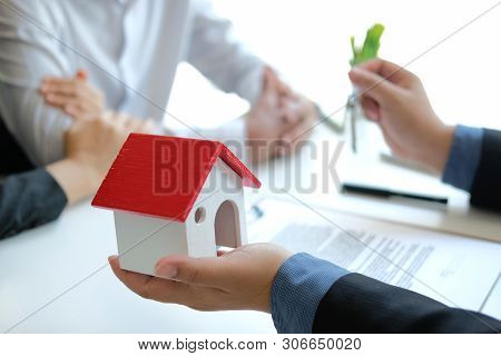 Lawyer Insurance Broker Consulting Giving Legal Advice To Couple Customer About Buying Renting House