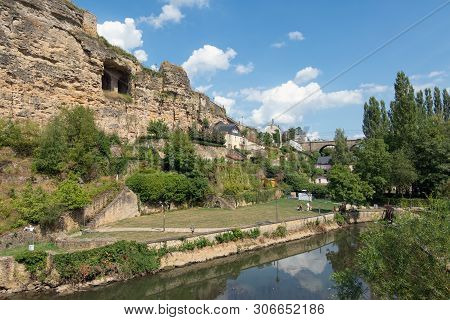 Alzette River Luxembourg City Downtown Grund With Medieval Fortifications And Recreating People In P