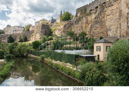 Alzette River Luxembourg City Downtown Grund With Medieval Fortifications And Vegetable Gardens At R