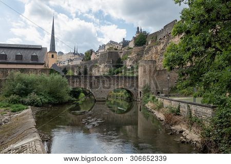 Alzette River Luxembourg City Downtown Grund With Medieval Fortifications And Old Stonebridge