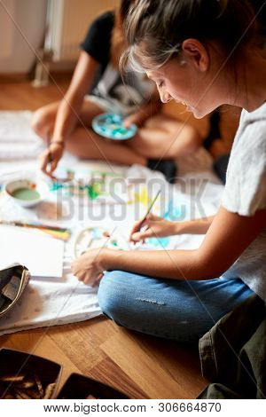 Girl enjoy in painting with temperas