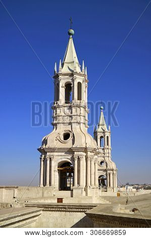 Stunning White Volcanic Stone Bell Tower Of Basilica Cathedral Of Arequipa Against Vibrant Blue Sky,