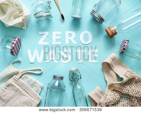 Zero Waste Concept. Textile Eco Bags, Glass Jars And Bamboo Toothbrush On Blue Background With Zero
