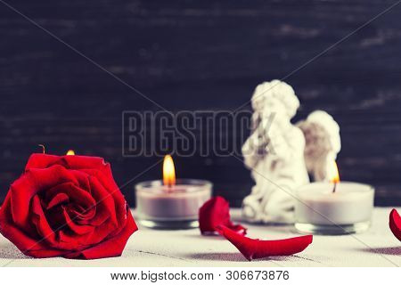 Mourning  Layout. Little Angel, Red Rose And Burning Candles On  Dark Background. Card For Mourning,